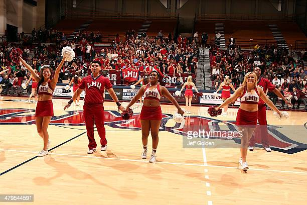 Tessa Soriano Ricky Leanos Drew Hutchinson Ally Doles and Kyle Burnett of the Loyola Marymount Lions Cheer Team perform during the first half of the...