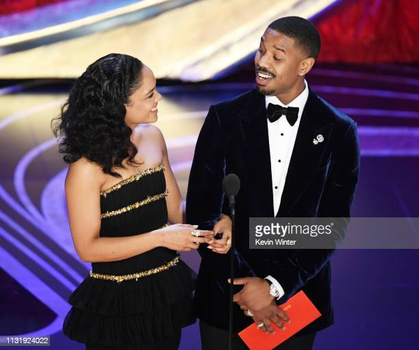 Tessa Thompson and Michael B Jordan speak onstage during the 91st Annual Academy Awards at Dolby Theatre on February 24 2019 in Hollywood California
