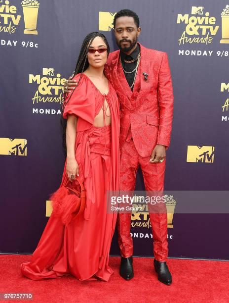 Tessa Thompson Lakeith Stanfield arrives at the 2018 MTV Movie And TV Awards at Barker Hangar on June 16 2018 in Santa Monica California
