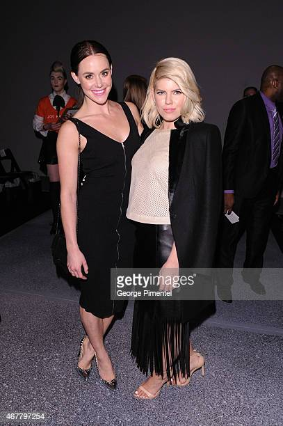 Tessa Virtue and LeeAnn Cuthbert attend World MasterCard Fashion Week Fall 2015 Collections Day 4 at David Pecaut Square on March 26 2015 in Toronto...