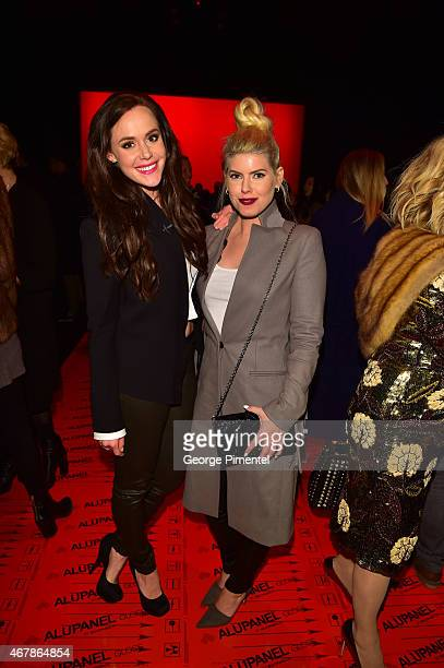 Tessa Virtue and LeeAnn Cuthbert attend World MasterCard Fashion Week Fall 2015 Collections Day 5 at David Pecaut Square on March 27 2015 in Toronto...