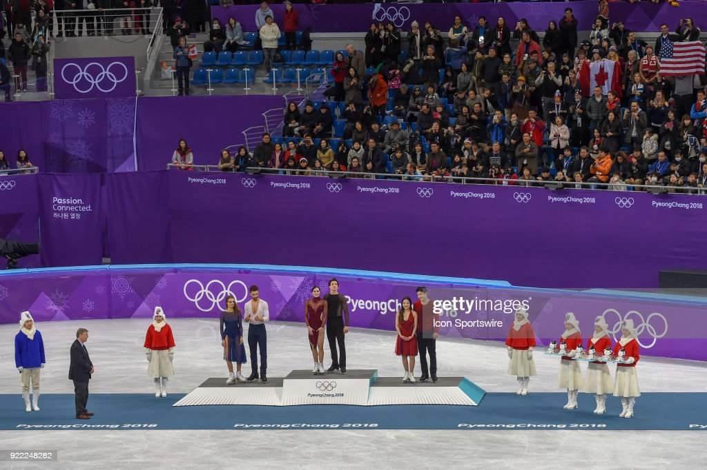 Tessa Virtue and Scott Moir (CAN), center, win the gold medal; Gabriella Papadakis and Guillaume Cizeron (FRA), left, win silver; and Maia and Alex Shibutani (USA) win the bronze medal in Ice Dancing during the 2018 Winter Olympic Games at the Gangneung Ice Arena on February 20, 2018 in PyeongChang, South Korea.