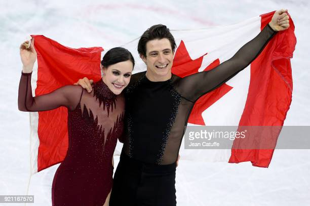 Tessa Virtue and Scott Moir of Canada celebrate the gold medal during the venue victory ceremony following the Figure Skating Ice Dance Free Dance...