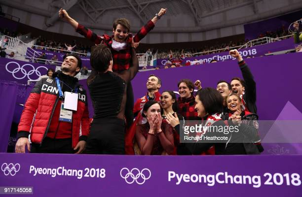 Tessa Virtue and Scott Moir of Canada celebrate with their team after receiving their score in the Figure Skating Team Event – Ice Dance Free Dance...