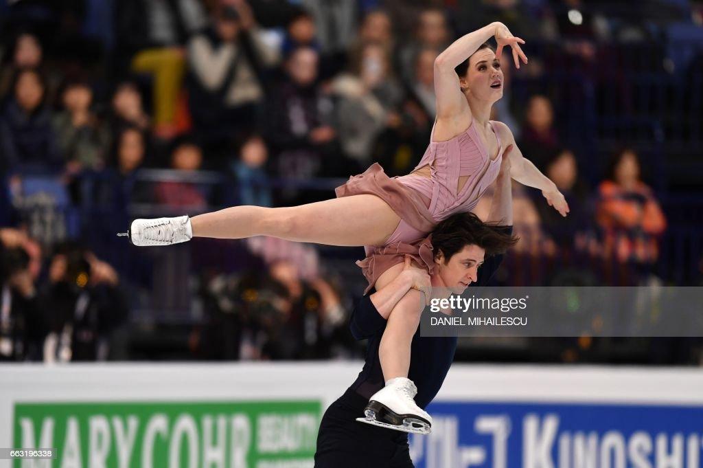 Tessa Virtue and Scott Moir of Canada perform their routine to win the Ice Dance / Free Dance event at the ISU World Figure Skating Championships in Helsinki, Finland on April 1, 2017. / AFP PHOTO / Daniel MIHAILESCU