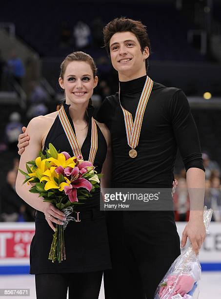 Tessa Virtue and Scott Moir of Canada pose with their bronze medals after competing in the Free Dance during the 2009 ISU World Figure Skating...