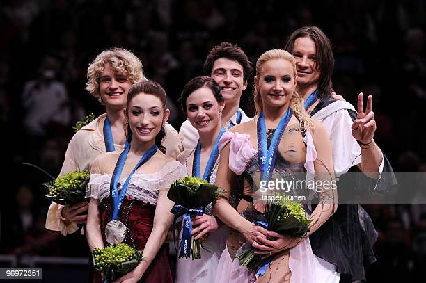 Tessa Virtue and Scott Moir of Canada pose with their gold medals after they won the Ice Dance competition on day 11 of the 2010 Vancouver Winter...