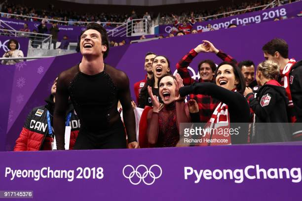 Tessa Virtue and Scott Moir of Canada react after receiving their score in the Figure Skating Team Event – Ice Dance Free Dance on day three of the...