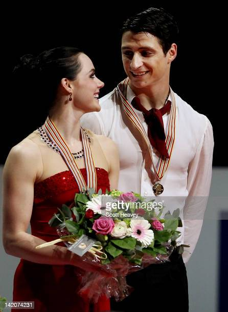 Tessa Virtue and Scott Moir of Canada receive their gold medals during day four of the ISU World Figure Skating Championships on March 29 2012 in...