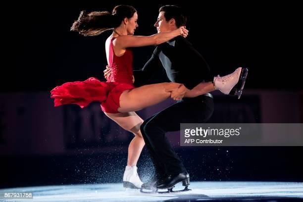 Tessa Virtue and Scott Moir of Canada skate their exhibition program at the ISU Grand Prix of Figure Skating's Skate Canada International at Brandt...