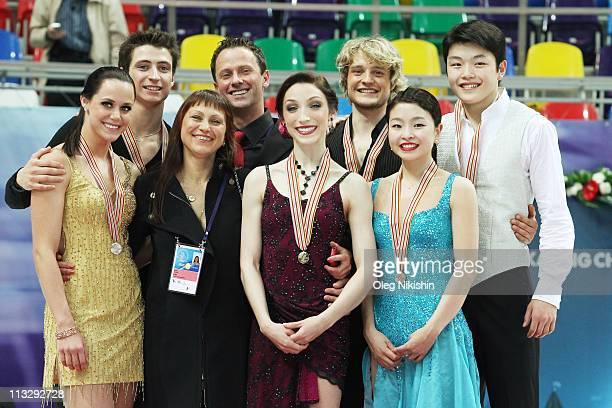 Tessa Virtue and Scott Moir of Canada their coaches Igor Shpilband and Marina Zueva Meryl Davis and Charlie White of USA Maia Shibutani and Alex...