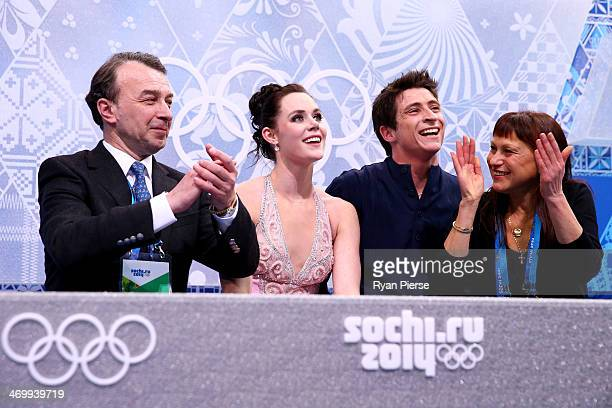 Tessa Virtue and Scott Moir of Canada wait for their score with their coaches Oleg Epstein and Marina Zoueva in the Figure Skating Ice Dance Free...