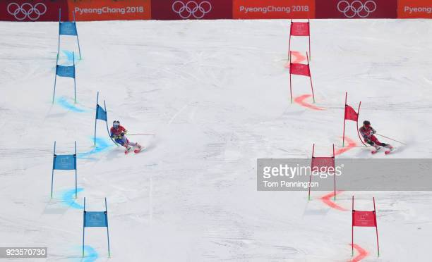 Tessa Worley of France and Erin Mielzynski of Canada compete during the Alpine Team Event 1/8 Finals on day 15 of the PyeongChang 2018 Winter Olympic...