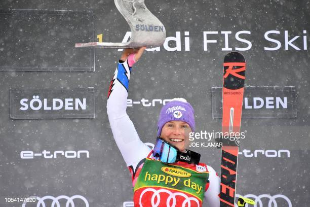 Tessa Worley of France poses with her trophy on the podium after winning the Women's giant slalom at the FIS ski World cup on October 27 2018 in...