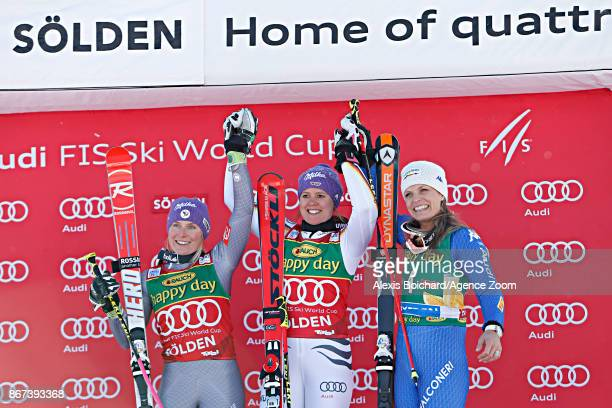 Tessa Worley of France takes 2nd place Viktoria Rebensburg of Germany takes 1st place Manuela Moelgg of Italy takes 3rd place during the Audi FIS...