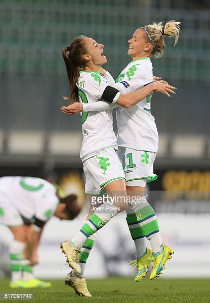 Tessa Wuellert of Wolfsburg celebrates with her team mate Julia Simic after scoring her team's first goal during the UEFA Women's Champions League...