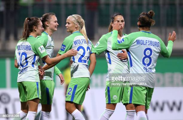 Tessa Wullaert Caroline Hansen Pernille Harder Sara Bjork Gunnarsdottir and Babett Peter of Wolfsburg celebrate after scoring during the UEFA Women...