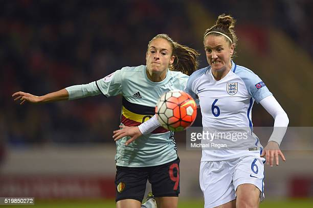 Tessa Wullaert of Belgium and Casey Stoney of England challenge for posetion during the UEFA Women's European Qualifer between England and Belgium at...