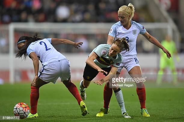 Tessa Wullaert of Belgium in action with Alex Scott and Katie Chapman of Englandduring the UEFA Women's European Qualifer between England and Belgium...