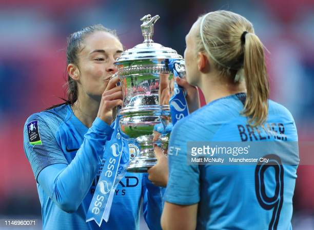 Tessa Wullaert of Manchester City Women and Pauline Bremer of Manchester City Women celebrate with the Women's FA Cup Trophy following their team's...