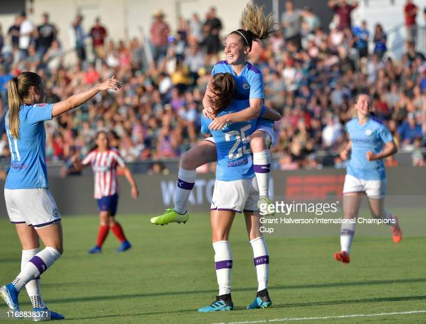 Tessa Wullaert of Manchester City Women is congratulated by her teammate Keira Walsh after scoring the game winning goal in the final minutes against...