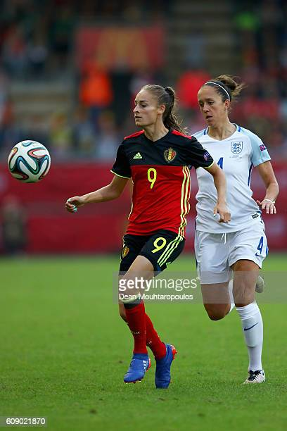 Tessa Wullaert of the Belgium battles for the ball with Josanne Potter of England during the UEFA Women's Euro 2017 Qualifier between Belgium and...