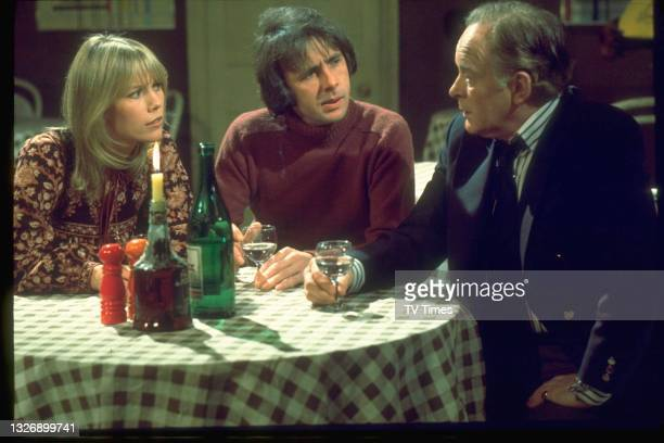 Tessa Wyatt, Richard O'Sullivan and Tony Britton in charcter as Vicky, Robin and James on the set of sitcom Robin's Nest, circa 1980.