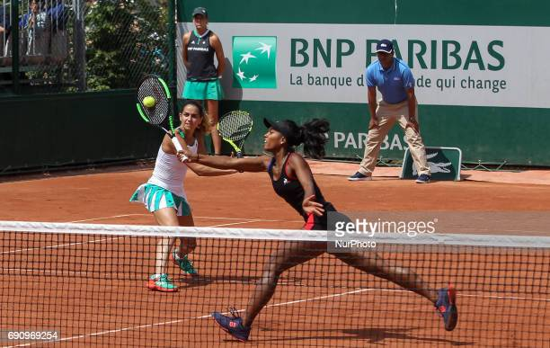 Tessah Andrianjafitrimo of France and Amandine Hesse of France plays against Tímea Babos of Hungary and Andrea Hlavackova of Czeh Republic at Roland...
