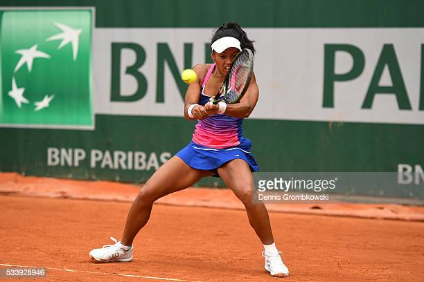 Tessah Andrianjafitrimo of France plays a backhand during the Women's Singles first round match against Qiang Wang of China on day three of the 2016...