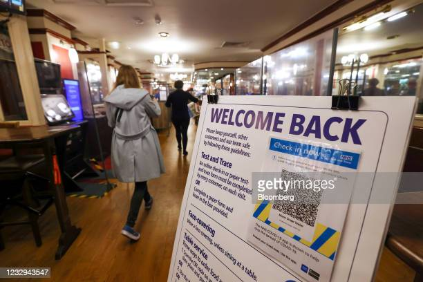 Test and trace instructions at the entrance to the Moon Under Water pub, operated by JD Wetherspoons Plc, ahead of opening for indoor customers in...