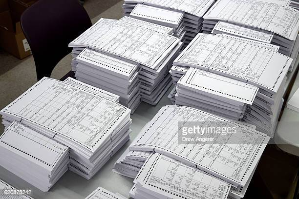 Test ballots wait to be scanned at a Board of Elections Elections voting machine facility warehouse November 3 2016 in the Bronx borough in New York...