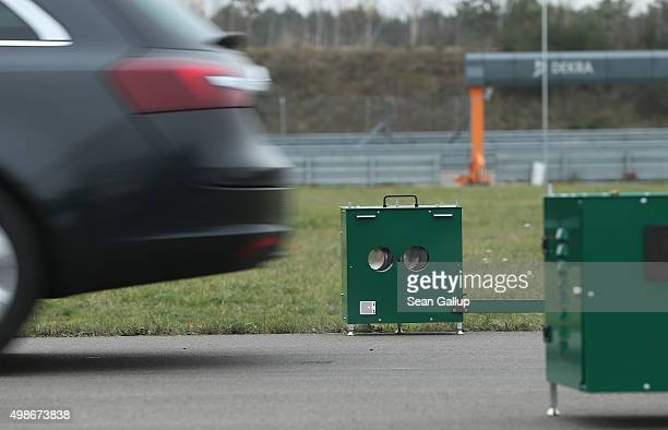 A test car passes through an Opus remote sensing device that uses lasers to measure emissions during a workshop for media on automobile emissions at...