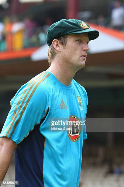 Test debutant Cameron White displays the green cap before the First Test between India and Australia at the MChinnaswamy Stadium on October 9 2008 in...