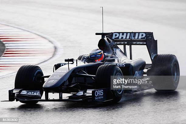 Test driver Nico Hulkenberg of Germany and Williams drives the new Williams FW31 Formula One car at the Autodromo Internacional do Algarve on January...