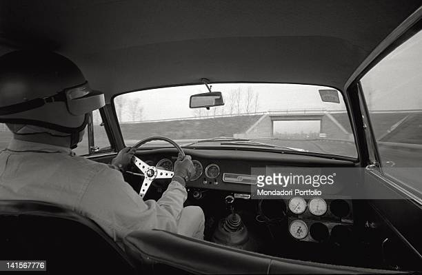 A test driver of the Alfa Romeo Italian car company being behind the wheel of a car on the Balocco trial track Balocco
