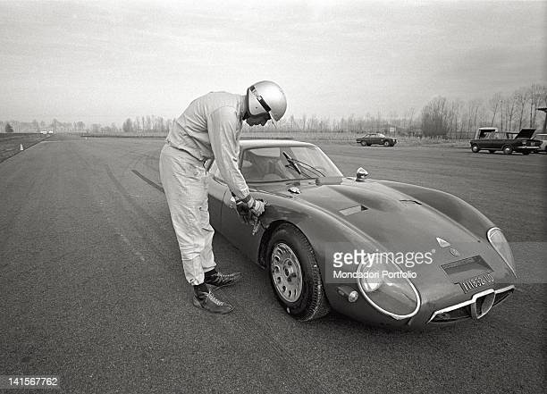 A test driver of the Alfa Romeo Italian car company checking a car in the Balocco trial track Balocco