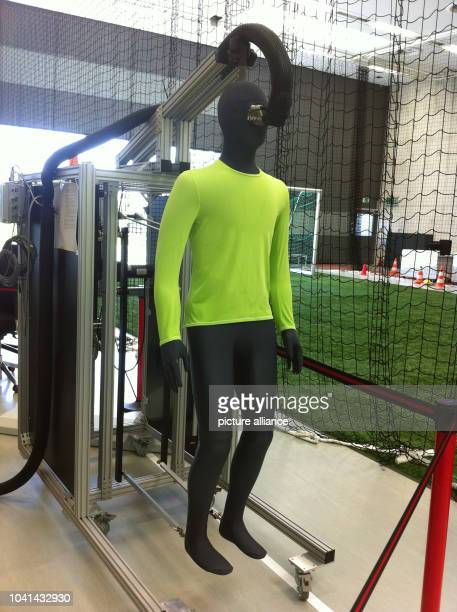 Test dummy Newton is pictured at the test centre of sports equipment manufacturer Adidas in Herzogenaurach Germany 18 June 2013 The hightech puppet...