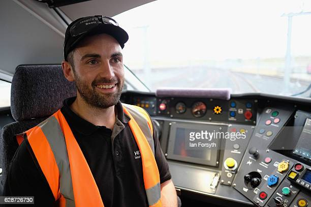 Test Engineer Scott Bibby sits in the driver's cab as the first British-built Intercity Express train is unveiled in front of invited guests at the...