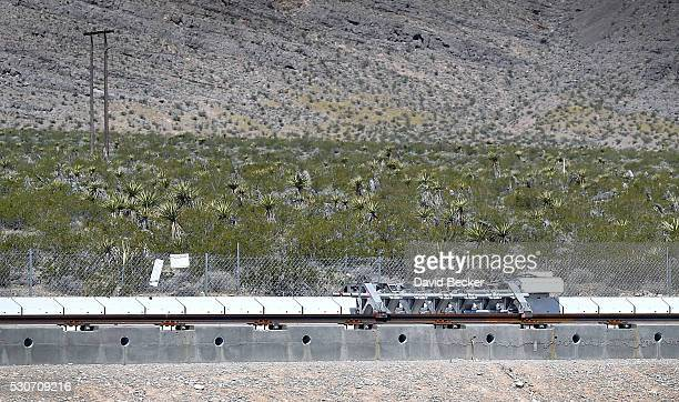 A test sled is propelled along a set of tracks during the first test of the propulsion system at the Hyperloop One Test and Safety site on May 11...