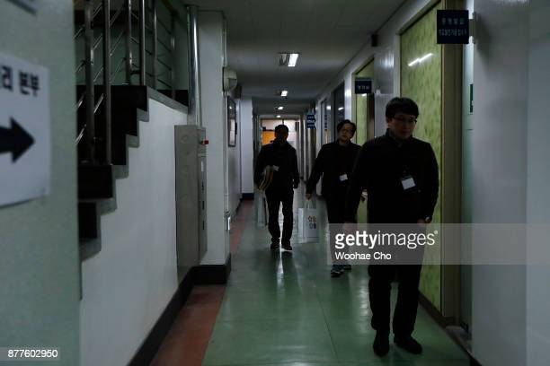 Test supervisors bring examination papers to the test room for the College Scholastic Ability Test on November 23 2017 in Seoul South Korea The test...