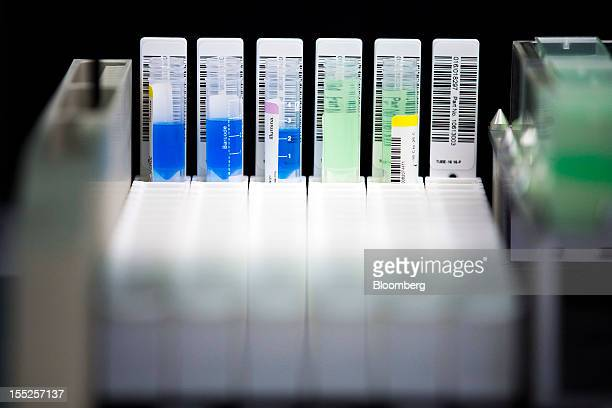 Test tubes containing liquids for use in a DNA sequencing experiment sit in a receptacle in a laboratory inside Nestle SA's Institute of Health...