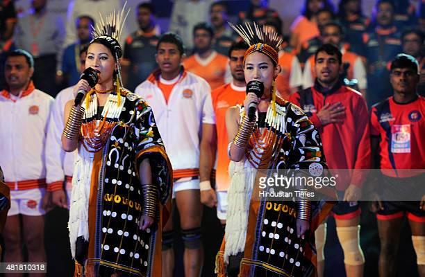 Testeo Sisters from Nagaland sing National Anthem during Pro Kabaddi league at Netaji Indoor Stadium on July 24 2015 in Kolkata India