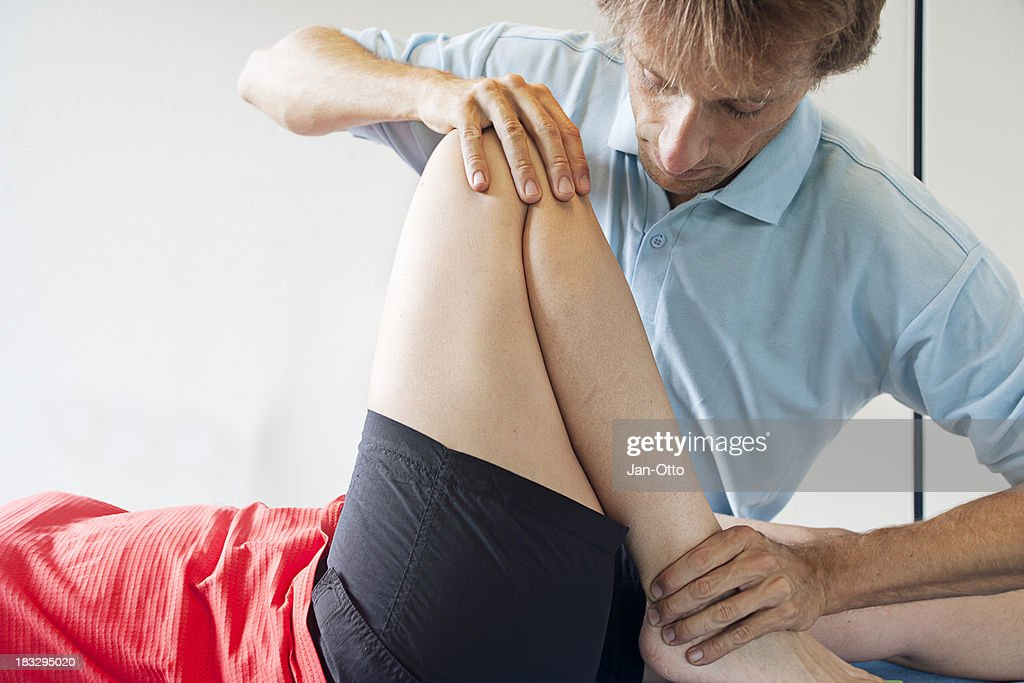Testing flexibility of a knee : Stock Photo