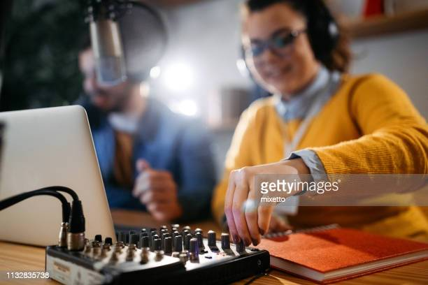 testing out podcast equipment - radio broadcasting stock pictures, royalty-free photos & images