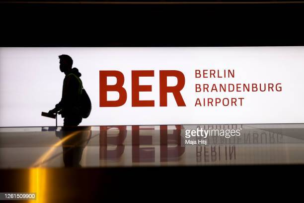 Testing passenger past by baggage claim during a trial run of the baggage system at Berlin Brandenburg Airport ahead of the new airport's opening...