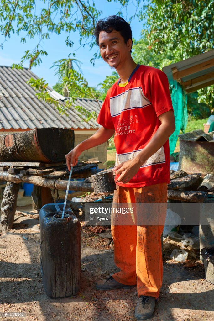 Testing the latex brought in by rubber tappers : Stock Photo