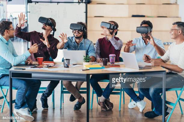 testing the new vr headsets - virtual reality simulator stock photos and pictures