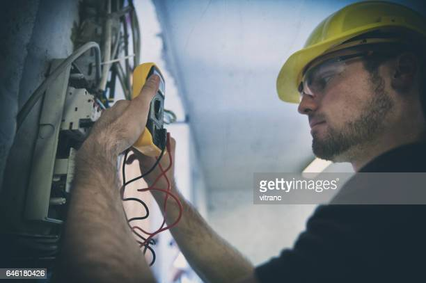 testing  voltage in a fuse box - fuse stock photos and pictures
