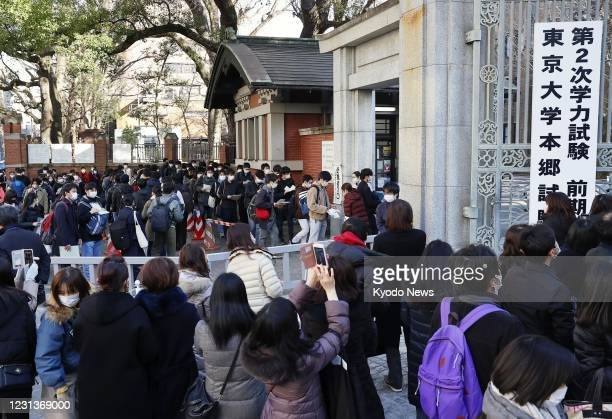 Test-takers gather at the venue of the University of Tokyo's entrance examination at a campus in Tokyo on Feb. 25, 2021.