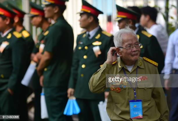 A Tet Offensive veteran arrives to attend a ceremony marking the 50th anniversary of the military assault in Ho Chi Minh City on January 31 2018...